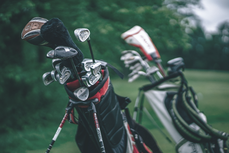 a picture that show many different types of golf clubs