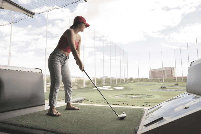a golfer who perfect her stand and grip