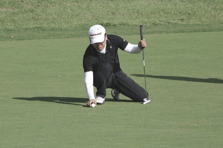 a man who is trying to practice and improve his golf putting to lower his  golf handicap
