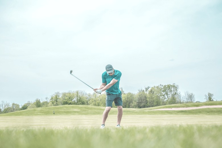a golfer who's performing his golf balls spin as a Best Golf Ball For High Handicappers