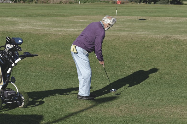 a senior golfer who's playing golf and describe What To Look For In Senior Golf Clubs